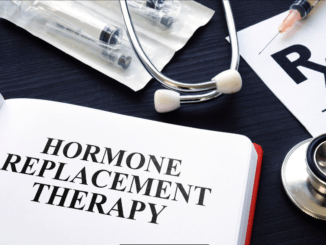 Book about Hormone Replacement Therapy and syringes