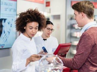 Dedicated female pharmacist checking a medical prescription