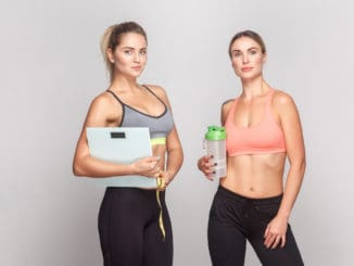 Weight loss, diet concept. Two instructor in top looking at camera and smiling