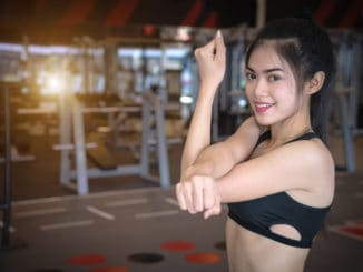 Sport woman exercising in gym