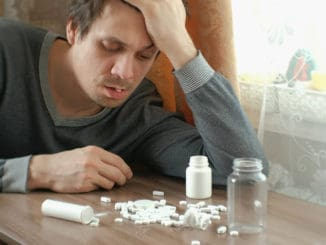 Man has a lot of pills and falls asleep
