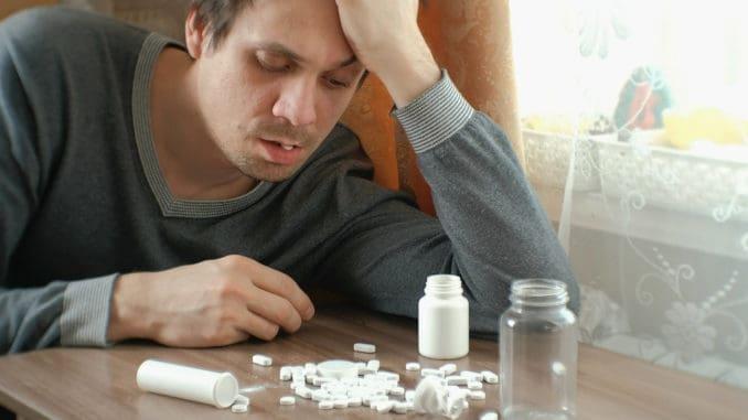 Man has a lot of pills and falls asleep