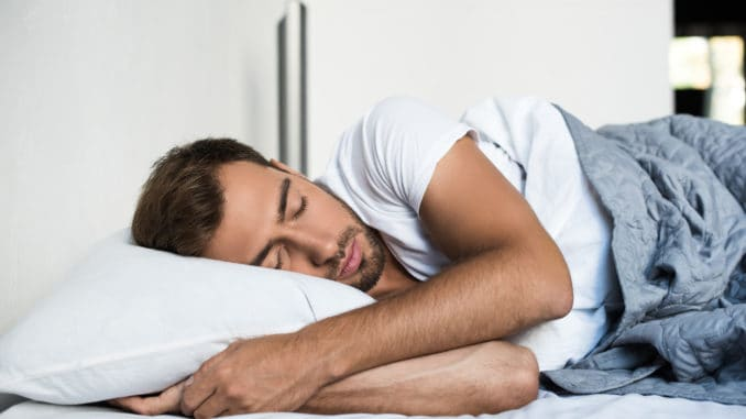 Attractive young man sleeping