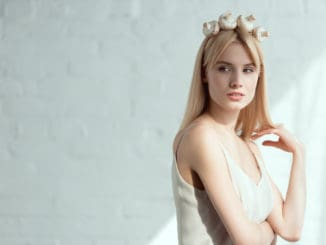 pretty pensive woman in dress with wreath made of fresh mushrooms on head vegan lifestyle concept