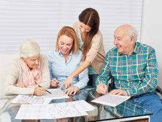 Family with seniors couple together makes memory training