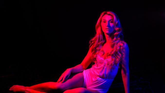Sensual girl with fit body in red light