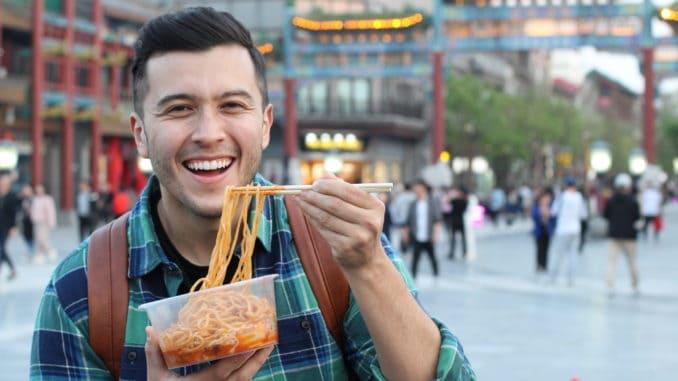 Man eating street food in Asia.