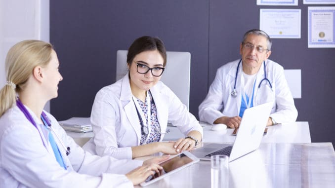Doctors having a medical discussion in a meeting room.