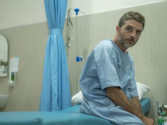 Scared and worried man hospitalized