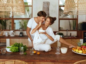Couple Cooking At Kitchen
