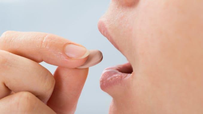 Person Taking Medicine Pill