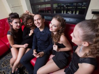 Portrait of lovelace men surrounded by hot women wanting of proposal from him
