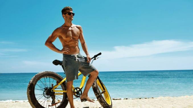 Fitness Male Model With Bike Sunbathing On Sun