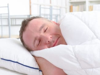 Man peacefully sleeping at home