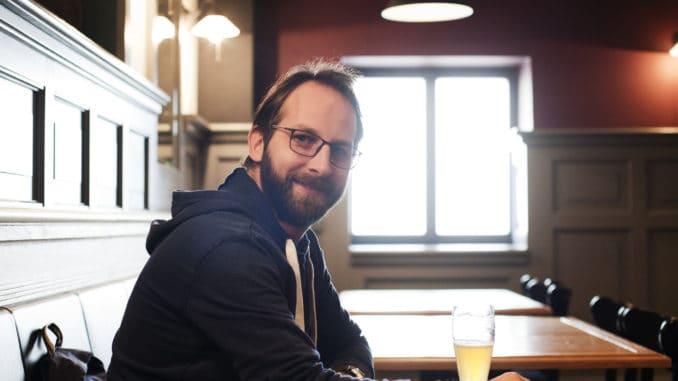Man drinking beer in a pub in Prague
