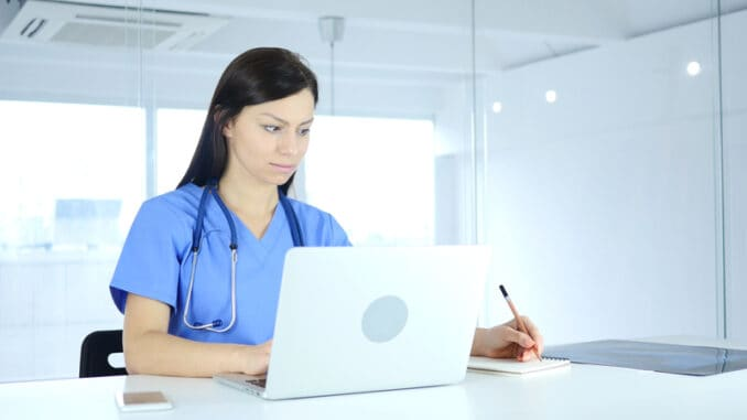 Doctor Writing Medical Reports of Patient