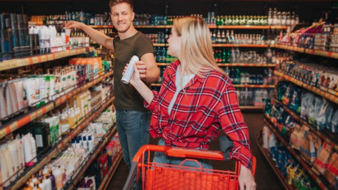 Young couple in grocery store.