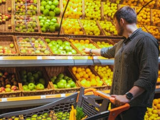 man in grocery store do shopping buying fruits copy space
