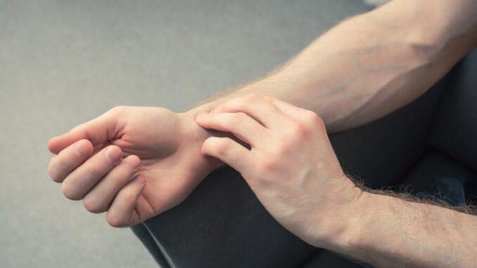 Man manually checks his pulse