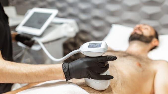 Man during an ultrasound liposuction procedure at luxury Spa salon