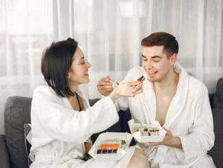 Eating sushi together.