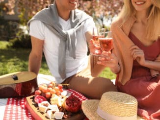 Happy couple having picnic in park on sunny day