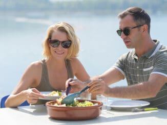 romantic couple having lunch outdoor
