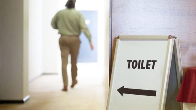 Man going to public toilet