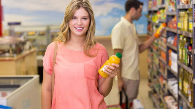 Portrait of a pretty smiling blonde women buying products at supermarket