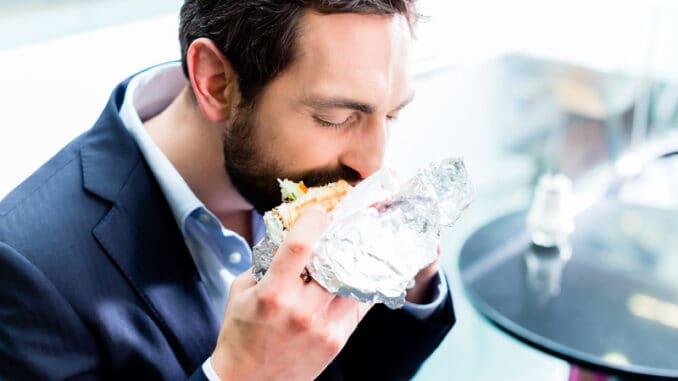 Man eating Doner Kebap in bistro