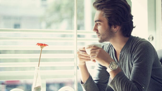 Young man drinking coffee in the cafe