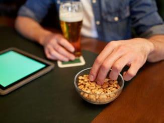 eating peanuts at bar