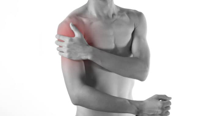 Young man arm and shoulder joint pain on white background.